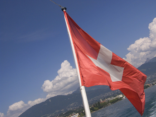swiss flag in the sun credits lozvizzero (CC BY-NC-ND 2.0)