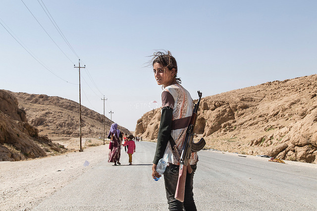 Yezidi girl carries an assault rifle to protect her family against ISIS credits Adam Rifkin via Flickr ( (CC BY 2.0)